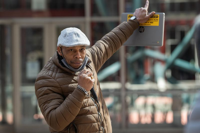 Mark Clements, a police torture survivor and a Chicago Torture Justice Center community organizer, speaks outside the James R. Thompson Center in the Loop, Friday morning, March 9, 2021, where members of End Illinois Prison Lockdown Coalition held a press conference demanding Gov. J.B. Pritzker to sign clemency petitions, end prison lockdowns, allow visits, improve COVID-19 safety precautions and release elderly, at-risk prisoners.