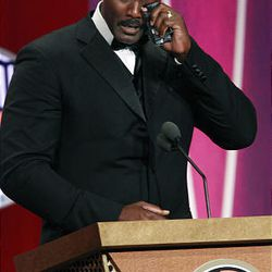 Karl Malone wipes away tears as he speaks during his enshrinement ceremony into the Basketball Hall of Fame on Friday in Springfield, Mass.