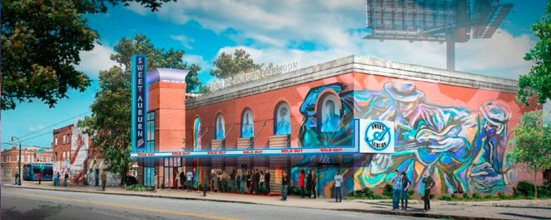 The exterior of the Sweet Auburn Ballroom in Atlanta. The facade has a colorful mural on it.
