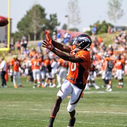 Broncos WR Emmanuel Sanders reaches out to make the grab during training camp.