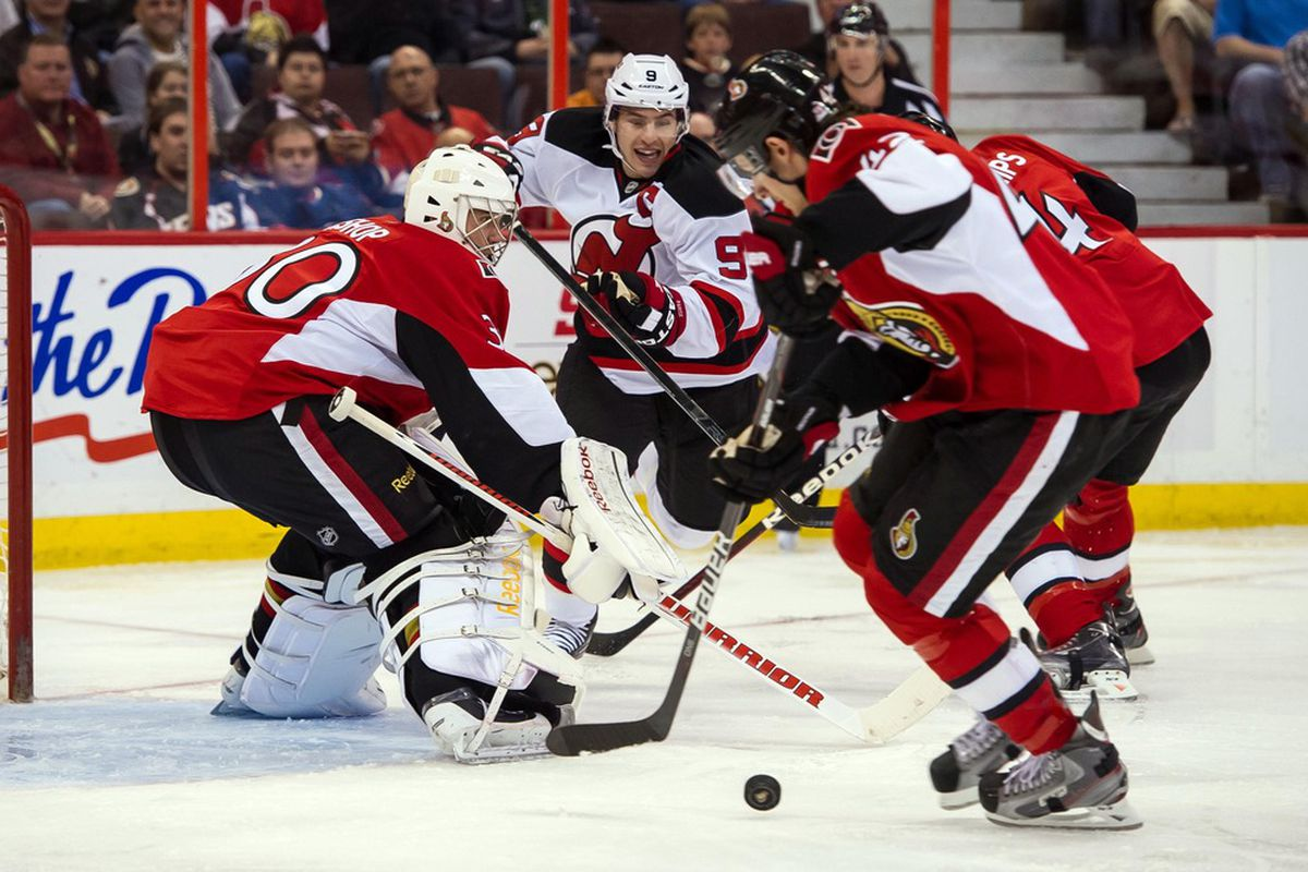 Mar 20, 2012; Ottawa, ON, CAN; Jim O'Brien's pencil-thin legs somehow manage to support his weight as he clears the puck from the front of his own net. Mandatory Credit: Marc DesRosiers-US PRESSWIRE