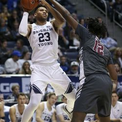 Brigham Young Cougars forward Yoeli Childs (23) shoots against Santa Clara Broncos center Jaden Bediako (12) at Brigham Young University in Provo on Thursday, Feb. 20, 2020.