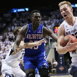 Brigham Young Cougars forward Eric Mika (12) takes the ball away from Texas Arlington Mavericks forward Kevin Hervey (25) as BYU and the University of Texas at Arlington play in NIT basketball action at the Marriott Center in Provo, Utah on Wednesday, March 15, 2017.