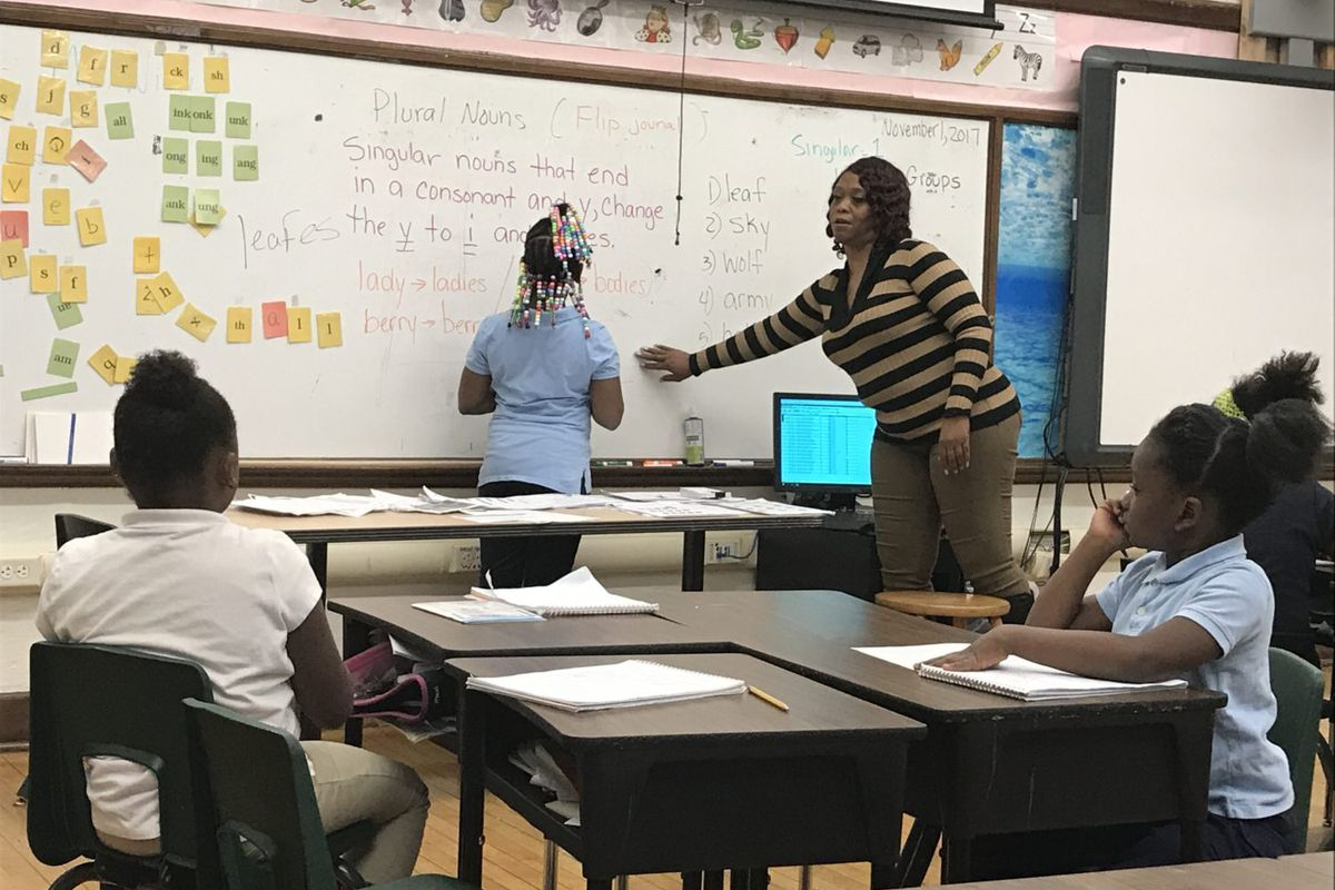 Second-grade teacher Angela Willis leads a reading lesson at Detroit's Bethune Elementary-MIddle School. Schools across the district will no longer be let out early on Wednesdays.