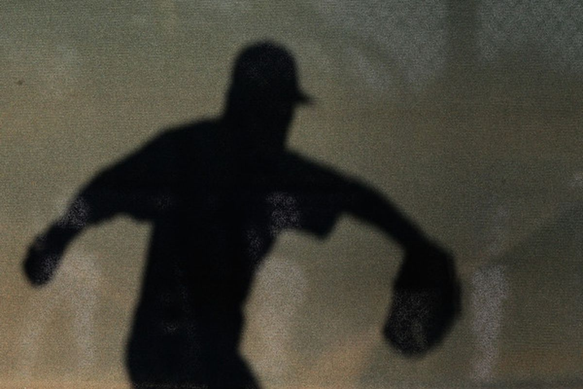 The shadow of pitcher Scott Elbert of the Los Angeles Dodgers as he throws warm ups before the spring training game against the San Francisco Giants at Camelback Ranch on March 4, 2011 (Photo by Christian Petersen/Getty Images)