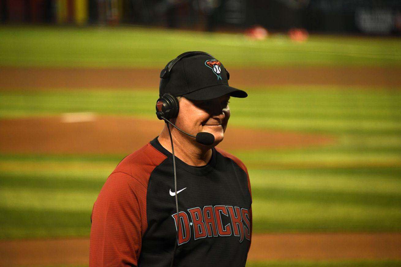Matt Herges does an interview through a headset before a Diamondbacks game
