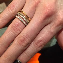 Two engagement bands in gold and white gold, $450 each