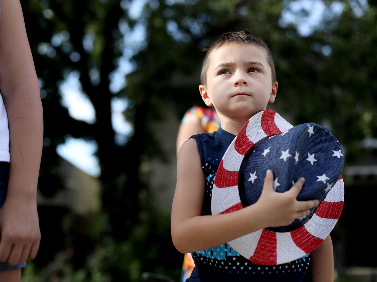 Tayson Dale, 6, stands as the Mormon Battalion color guard passes by during the 2019 Days of '47 Parade in Salt Lake City.