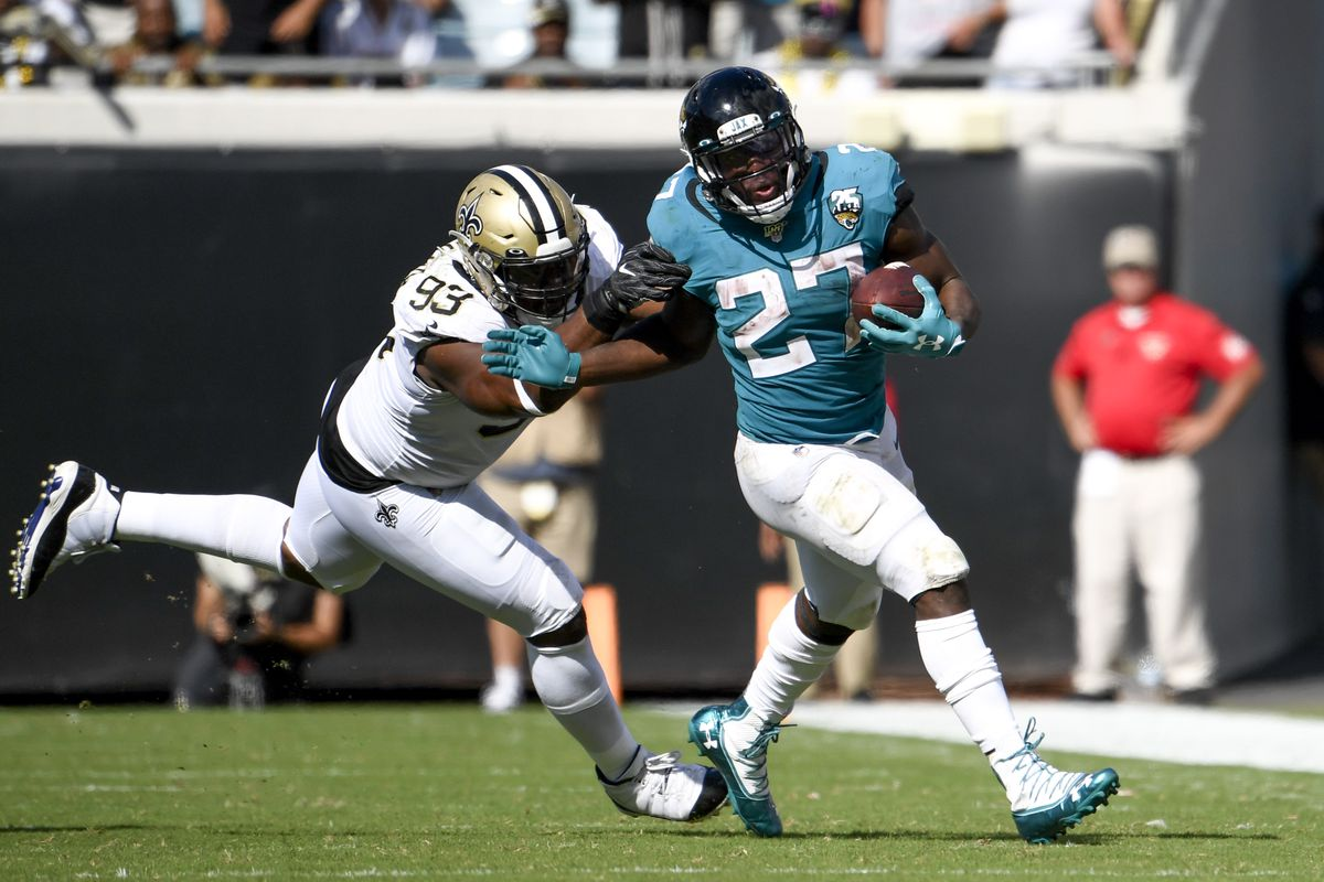 Jacksonville Jaguars running back Leonard Fournette runs the ball against New Orleans Saints defensive tackle David Onyemata during the fourth quarter at TIAA Bank Field.