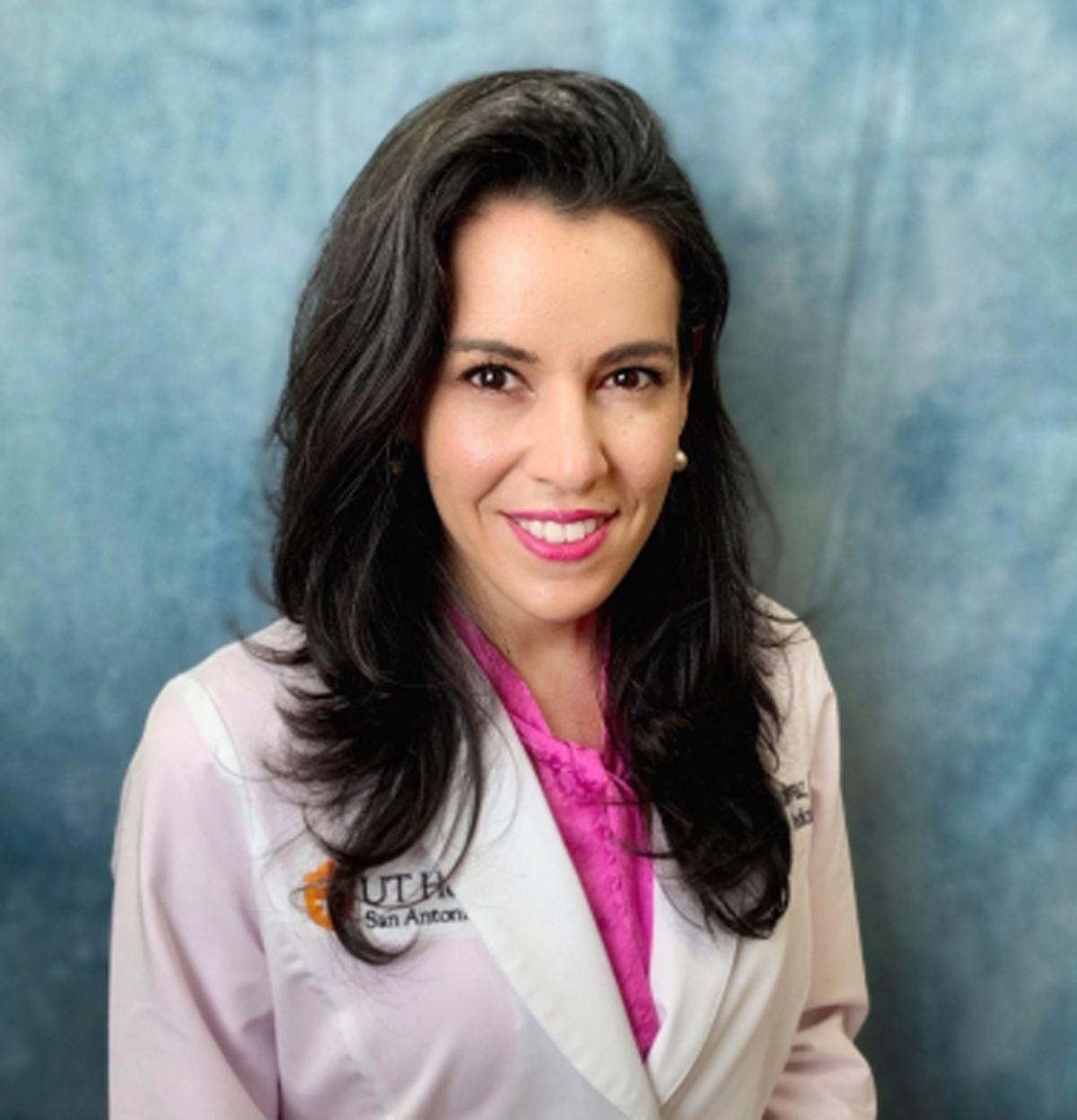 """Dr. Monica Verduzco-Gutierrez: initial test """"not as important as the symptoms."""""""