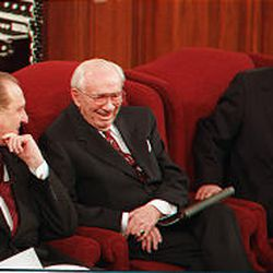 President Hinckley laughs with counselors Thomas S. Monson and James E. Faust at the closing of the Sunday afternoon session of general conference on April 4,1999.