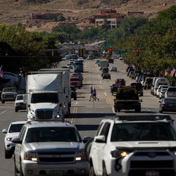 Cars, trucks and pedestrians jockey for space on Moab's busy Main Street on Friday, Sept. 9, 2016.
