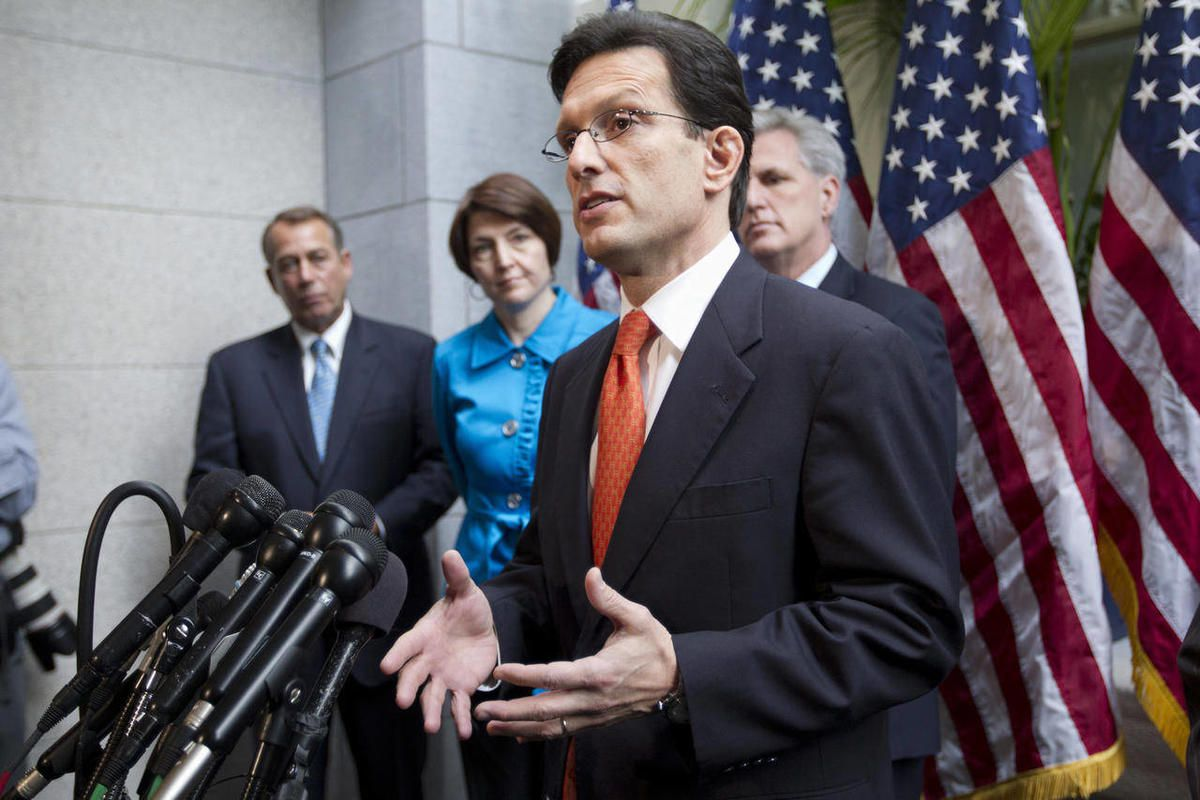 FILE - In this Feb. 15, 2012, file photo, House Majority Leader Eric Cantor of Va., accompanied by fellow  GOP leaders, gestures during a news conference on Capitol Hill in Washington, to discuss the payroll tax cut negotiations. From left are, House Spea