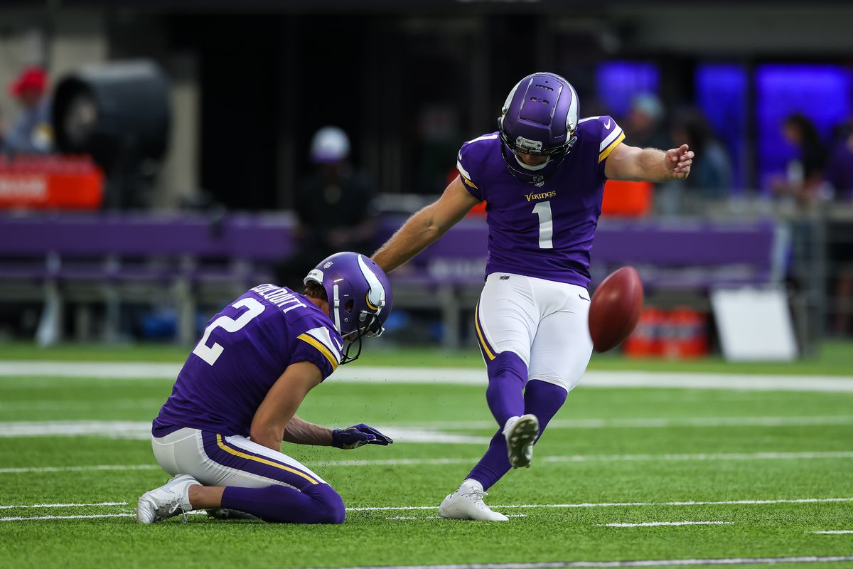 Greg Joseph #1 kicks the ball while Britton Colquitt #2 of the Minnesota Vikings holds before the start of a preseason game against the Indianapolis Colts at U.S. Bank Stadium on August 21, 2021 in Minneapolis, Minnesota.