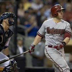 Arizona Diamondbacks' Miguel Montero, right, watches his double as San Diego Padres catcher Yasmani Grandal, left, looks on during the eighth inning of their baseball game Friday, Sept. 7, 2012, in San Diego. Montero's hit knocked in two runs to tie the game in the eighth inning.