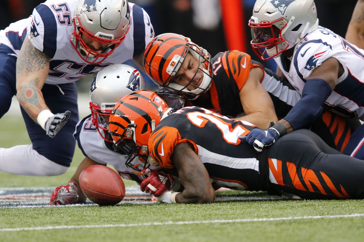 Cincinnati Bengals wide receiver Alex Erickson muffs the punt as New England Patriots defensive end John Simon and cornerback Tony McRae scramble for the loose ball during the second quarter at Paul Brown Stadium