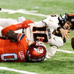 Oregon State Beavers quarterback Chance Nolan (10) reaches for the ball as he is sacked by Utah Utes linebacker Devin Lloyd (0) as Utah and Oregon State play a college football game at Rice Eccles stadium in Salt Lake City on Sunday, Dec. 6, 2020. Utah won 30-24.