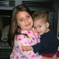 Sydney Sherwood, then 6, cuddles her baby brother Billy. He was diagnosed with neuroblastoma when he was 13 months old.