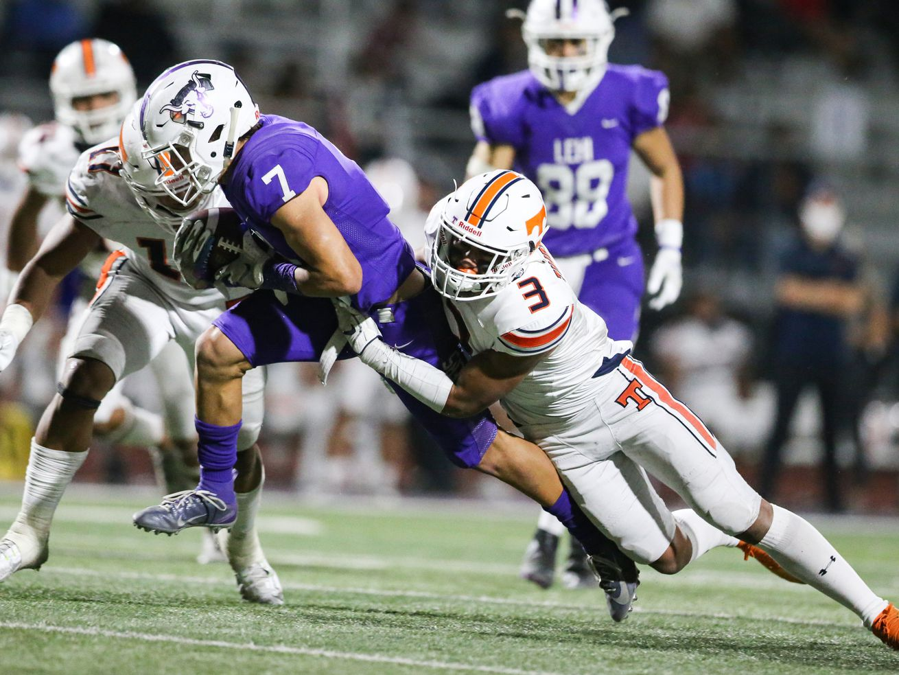 Lehi's Grady Gonzalez (7) carries the ball for a first down against Timpview's Raider Damuni (3) during a high school football game at Lehi High School in Lehi on Friday, Sept. 25, 2020.