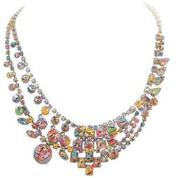 """<i>Tom Binns, <a href=""""https://editorialist.com/jewelry/product/munity-of-splender-necklace"""">$1,250</a></i><br> """"We love the idea of updating your spring wardrobe with the bold colors and graphic effects in some of these wearable works-of-art."""""""