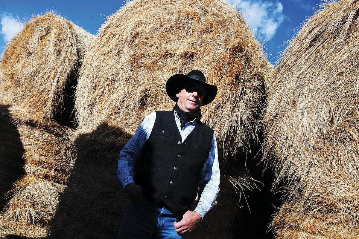 Saratoga, Wyo.  rancher Jack Berger stands with some of the hay he carried over from last year on April 20, 2012. The year set records for dryness, Barkhurst said, and 2012 is starting to look similar based on the U.S. Department of Agriculture's snowpack