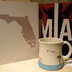 Lucius Designs Wall Art, $39; Downing Pottery Miami Cityscape Mug, $36