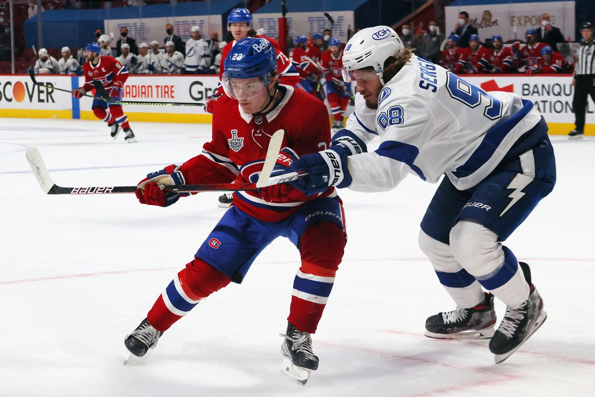 Mikhail Sergachev #98 of the Tampa Bay Lightning checks Cole Caufield #22 of the Montreal Canadiens during Game Three of the 2021 NHL Stanley Cup Final at the Bell Centre on July 02, 2021 in Montreal, Quebec, Canada.