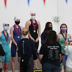 Swimmers receive their awards at the 6A girls swim championship at Kearns Oquirrh Park Fitness Center in Kearns on Saturday, Feb. 20, 2021.