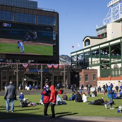 Fans watch the Chicago Cubs Opening Day game against the Pittsburgh Pirates outside Wrigley Field.