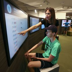Janelle Dickenson and her son Levi Burton learn where their ancestors came from at The Church of Jesus Christ of Latter-day Saints Family History Library in Salt Lake City on Tuesday, July 6, 2021. The library reopened its doors after 16 months of closure.