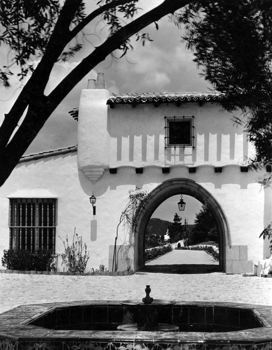 The exterior of a large white archway.