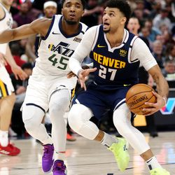 Utah Jazz guard Donovan Mitchell (45) can't keep up with Denver Nuggets guard Jamal Murray (27) as the Utah Jazz and the Denver Nuggets play an NBA basketball game at Vivint Arena in Salt Lake City on Wednesday, Feb. 5, 2020. Denver won 98-95, giving the Jazz their fifth straight loss.