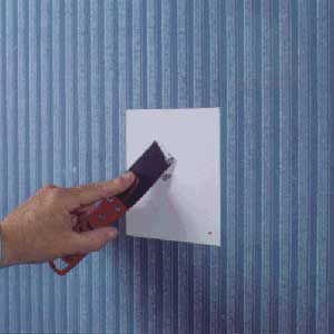 <p>FILL ANY HOLES with spackling compound after removing the patch and peeling off the damaged wallpaper section.</p>