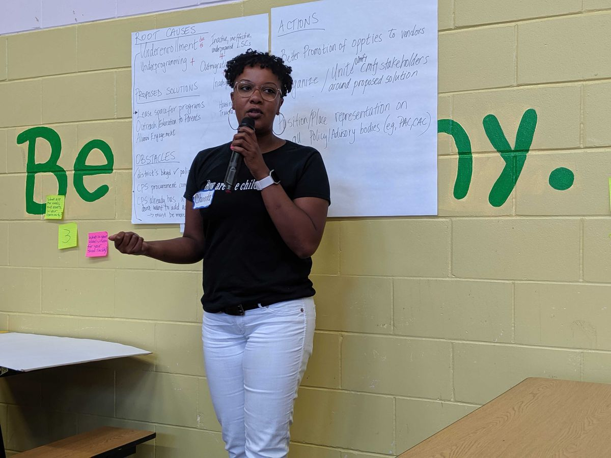 Attendee Chanita Jones-Howard shares the problems and solutions to school facility and enrollment.