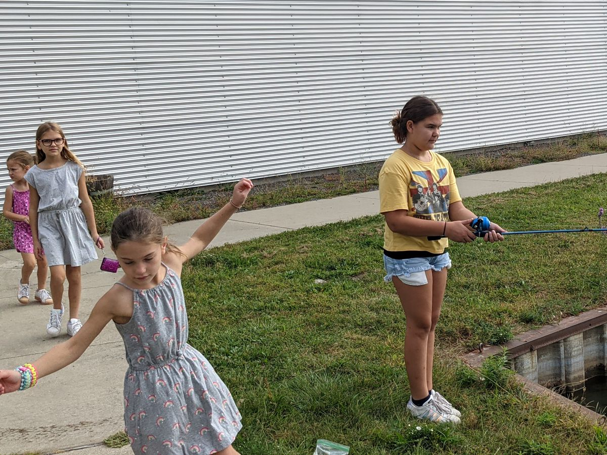 Juliana Senorskitried to teach her younger sisters—(front to back) Angelina, Josie, Frankie—how to cast and fish , but they seemed to have their own thingSaturday at the Chicago Family Outdoor Day at William W. Powers State Recreation Area. Credit: Dale Bowman
