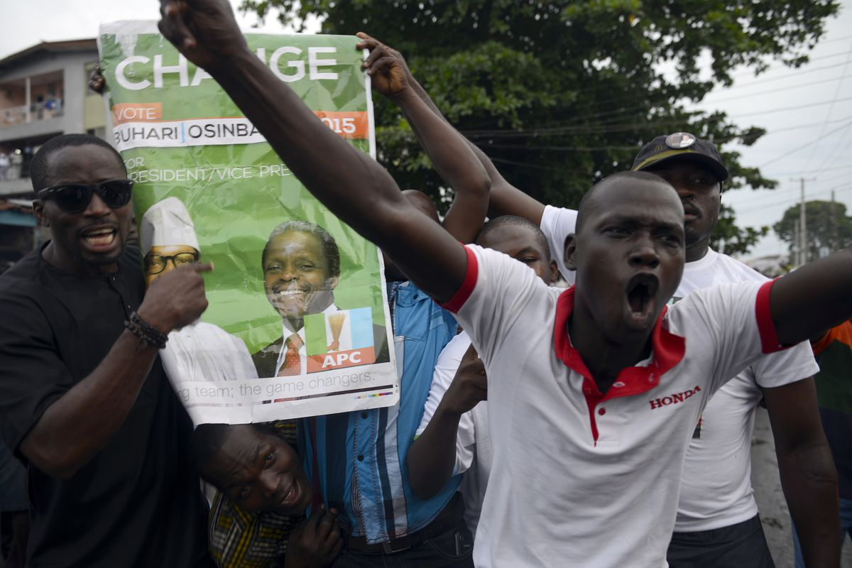 Supporters of Nigerian opposition leader Muhammadu Buhari celebrate the result.