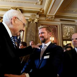Elder L. Tom Perry, a member of the Quorum of the Twelve Apostles of The Church of Jesus Christ of Latter-day Saints, and Troy Williams, executive director of Equality Utah, shake hands after a historic piece of legislation was announced that will protect Utah's lesbian, gay, bisexual and transgender community from discrimination in housing and employment while maintaining equal protection for the expression of religious beliefs at the Capitol in Salt Lake City, Wednesday, March 4, 2015. On the right is Clifford Rosky, Board Chair of Equality Utah.