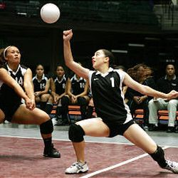Michelle Charboneau (right) and Priscilla Lolohea play defense for the Highland Rams during the 4A volleyball title game against Cottonwood.