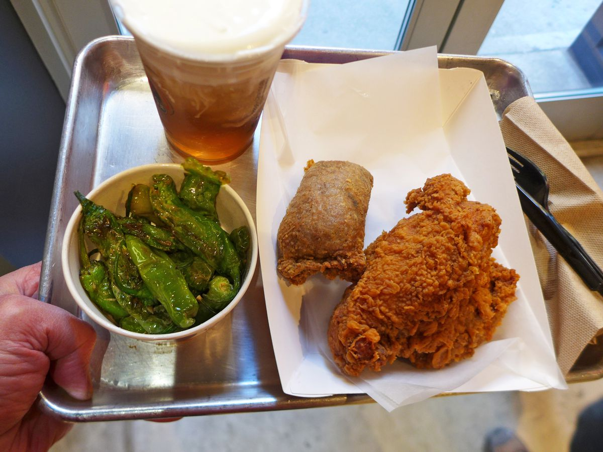 TKK Fried Chicken plate with tea and shishito peppers.