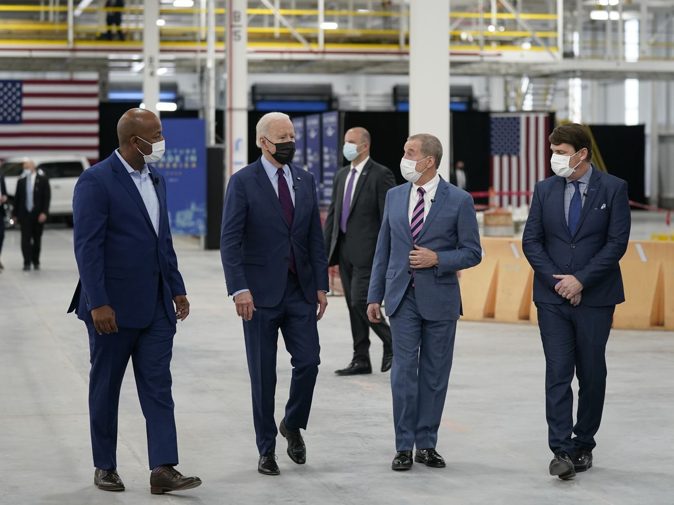 """President Joe Biden tours the Ford Rouge EV Center, Tuesday, May 18, 2021, in Dearborn, Mich. From left, Corey Williams, plant manager, Biden, William """"Bill"""" Ford, Jr., Executive Chairman, Ford Motor Company and Jim Farley, CEO, Ford Motor Company."""