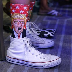 A supporter of Republican presidential candidate Donald Trump wears socks with his face on them during a speech by Trump to the National Association of Home Builders on Thursday, Aug. 11, 2016, in Miami Beach, Fla.