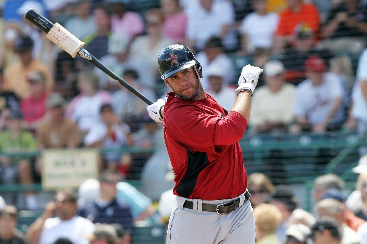 March 24, 2012; Bradenton, FL, USA; Houston Astros left fielder J.D. Martinez (14) on deck to bat in the second inning against the Pittsburgh Pirates at McKechnie Field.  Mandatory Credit: Kim Klement-US PRESSWIRE