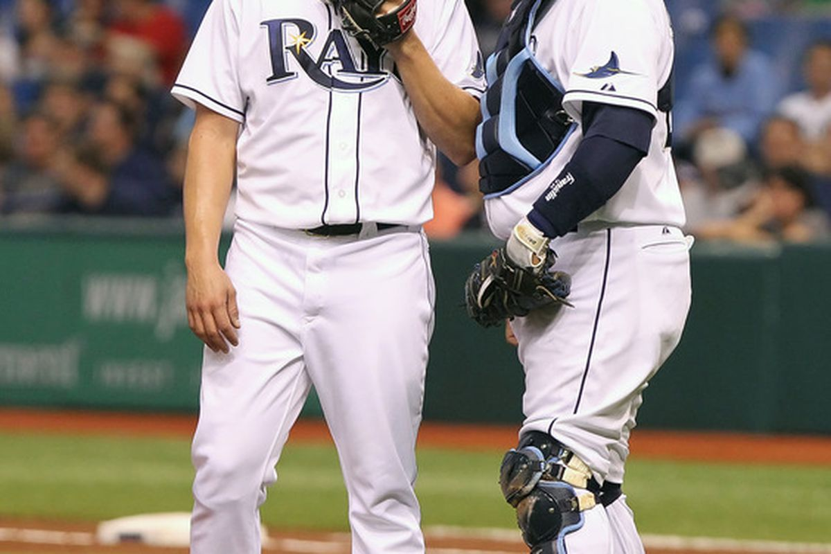 May 18, 2012; St. Petersburg, FL, USA; Tampa Bay Rays catcher Jose Molina (right) talks with starting pitcher James Shields (left) in the first inning against the Atlanta Braves at Tropicana Field. Mandatory Credit: Kim Klement-US PRESSWIRE