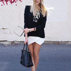 "Shea of <a href=""http://peaceloveshea.com/"">Peace Love Shea</a> is wearing a Helmut Lang blazer, an Urban Outfitters shirt, a Zara skirt, a Prada bag and sunglasses, <a href=""http://www.shopbop.com/michelet-mesh-bootie-b-brian/vp/v=1/1538053670.htm?folder"