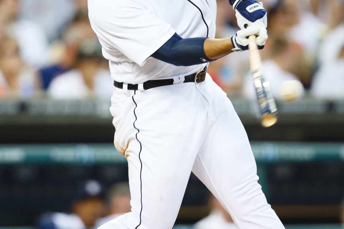 August 3, 2012; Detroit, MI, USA; Detroit Tigers third baseman Miguel Cabrera (24) hits an RBI single during the fourth inning against the Cleveland Indians at Comerica Park. Mandatory Credit: Rick Osentoski-US PRESSWIRE