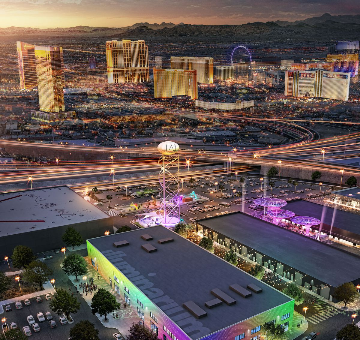 A view of an outdoor/indoor entertainment complex with the skyline of Las Vegas in the background