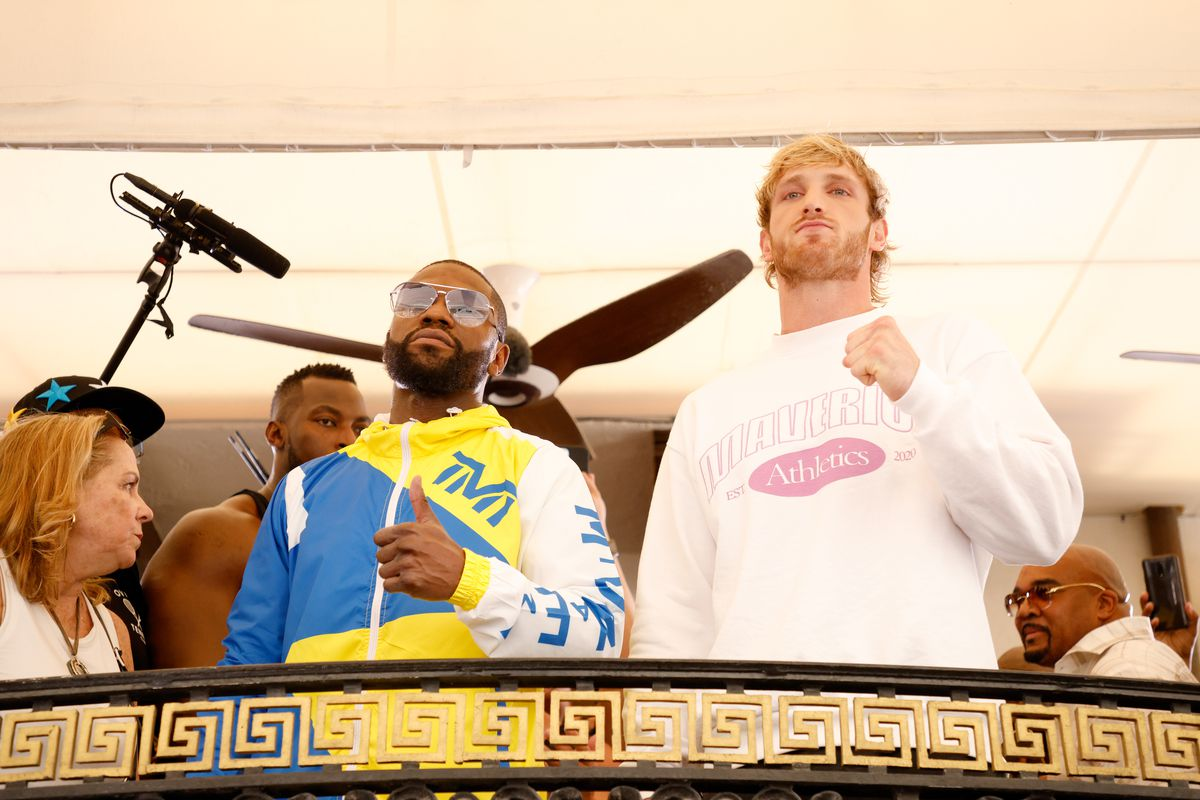 Floyd Mayweather and Logan Paul face off during media availability ahead of their June 6th exhibition boxing match on June 03, 2021 at Villa Casa Casuarina at the former Versace Mansion in Miami Beach, Florida.