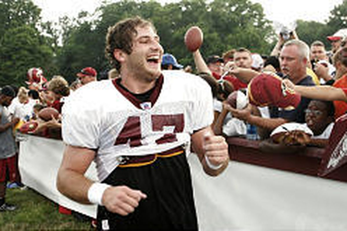 Former Utah State star Chris Cooley talks to fans after a Washington Redskins practice during training camp.