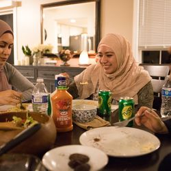 With Mexican culture still very much intact, recent Islamic converts Maria Ontiveros, Felicia Salameh and Jessica Salgado all eat enchiladas for their Iftar meal on June 5, 2018 in Orland Park, IL. This breaks their Ramadan fast, where there is no food or water consumed from sun up to sun down. I Maria de la Guardia/Sun-Times enchiladas for their Iftar meal on June 5, 2018. This breaks their Ramadan fast, where there is no food or water consumed from sun up to sun down. I Maria de la Guardia/Sun-Times