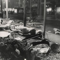 Mannequins, stripped of their finery, lie in the street after W. Madison looters left the scene April 7, 1968.